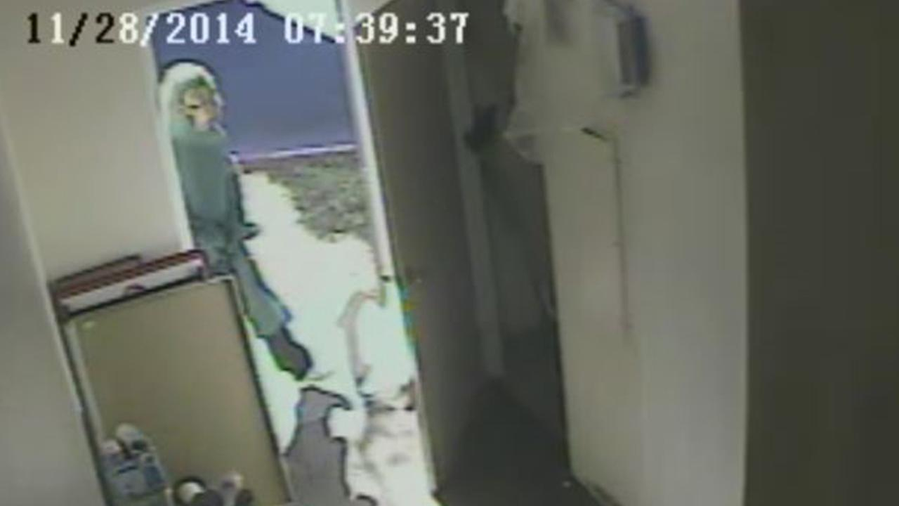 Surveillance video shows a man wearing an apparent werewolf mask entering a check cashing store in Chino on Friday, Nov. 28, 2014.