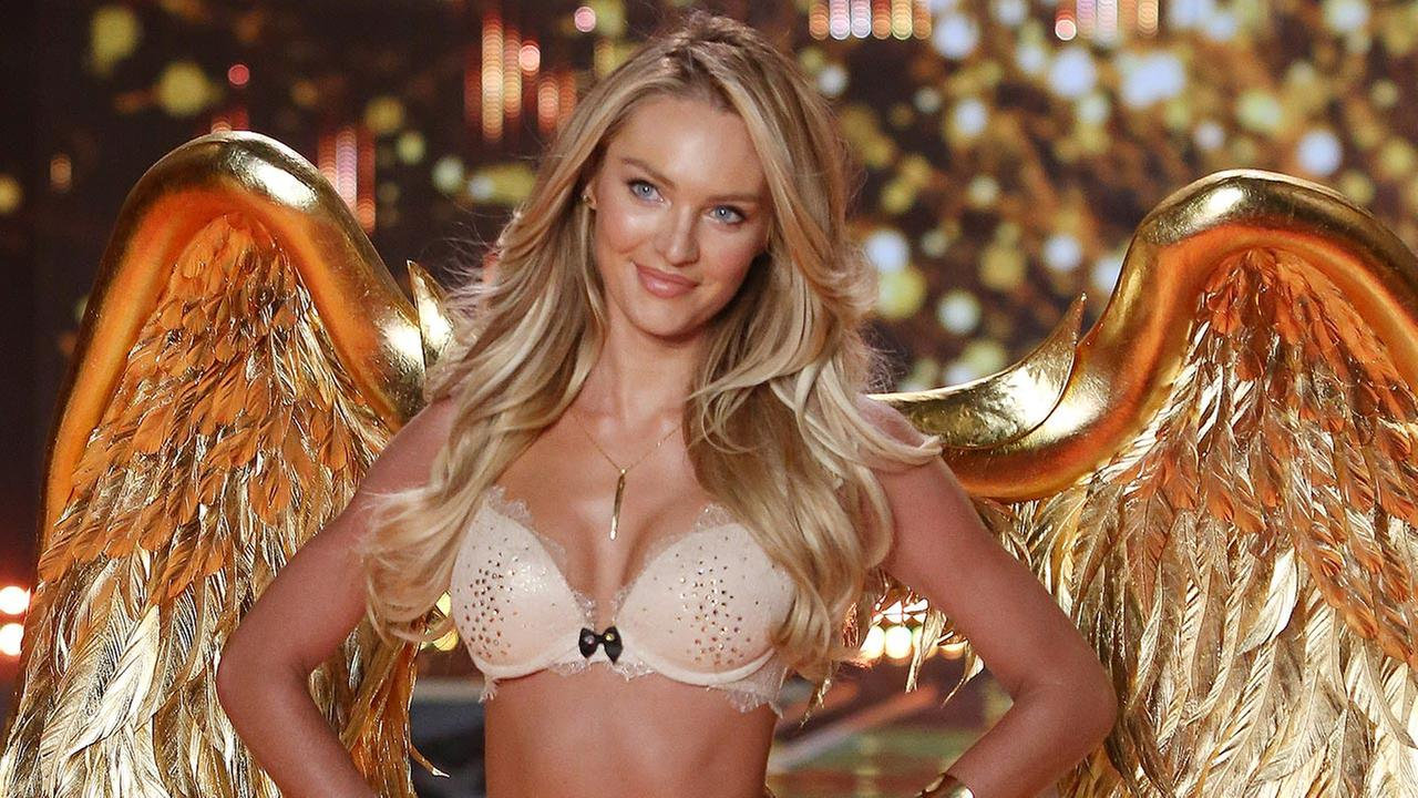 Model Candice Swanepoel walks the runway at the Victorias Secret fashion show in London, Tuesday, Dec. 2, 2014.
