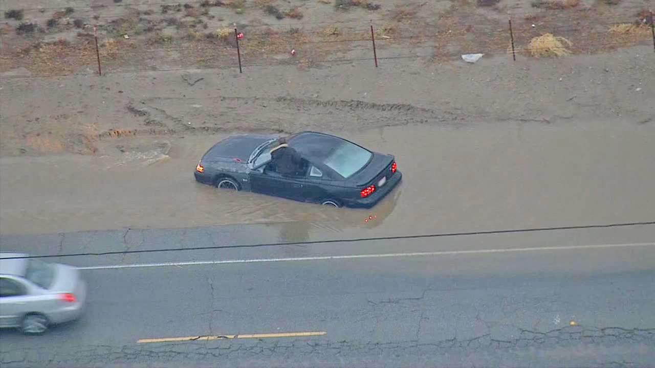 A vehicle was trapped on a flooded street in Hemet on Thursday, Dec. 4, 2014.