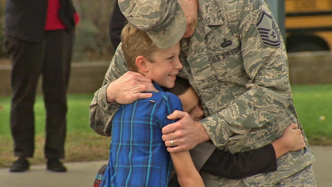 Air Force MSgt. Branden Shepperd hugs his two sons at Grace Miller Elementary in La Verne on Friday, Dec. 5, 2014.
