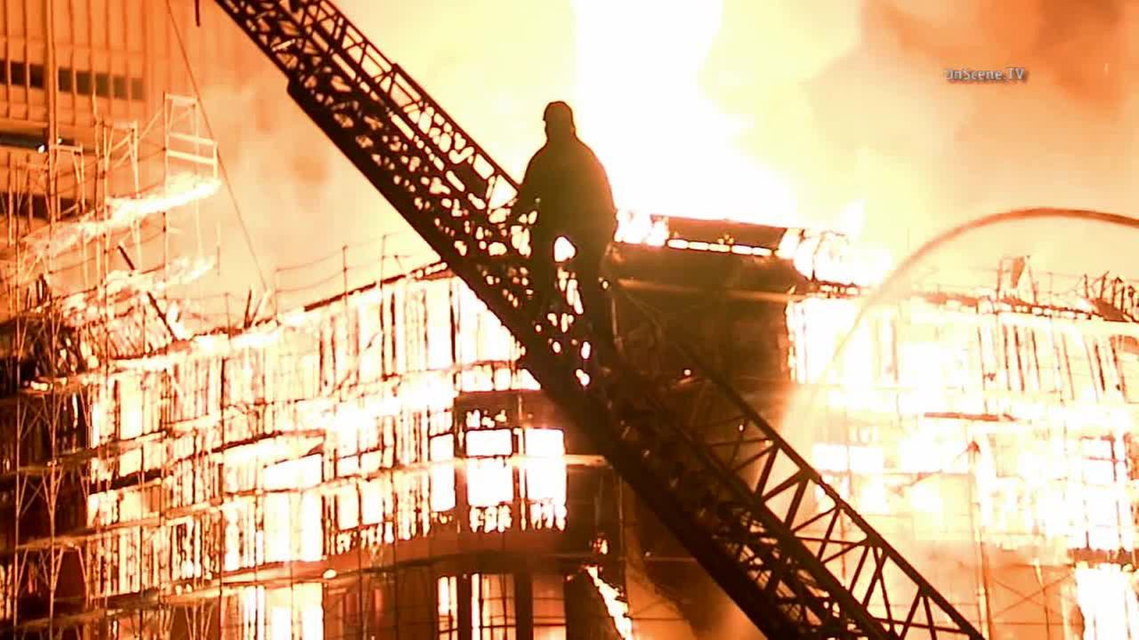 An apartment complex under construction caught fire in downtown Los Angeles on Monday, Dec. 8, 2014.