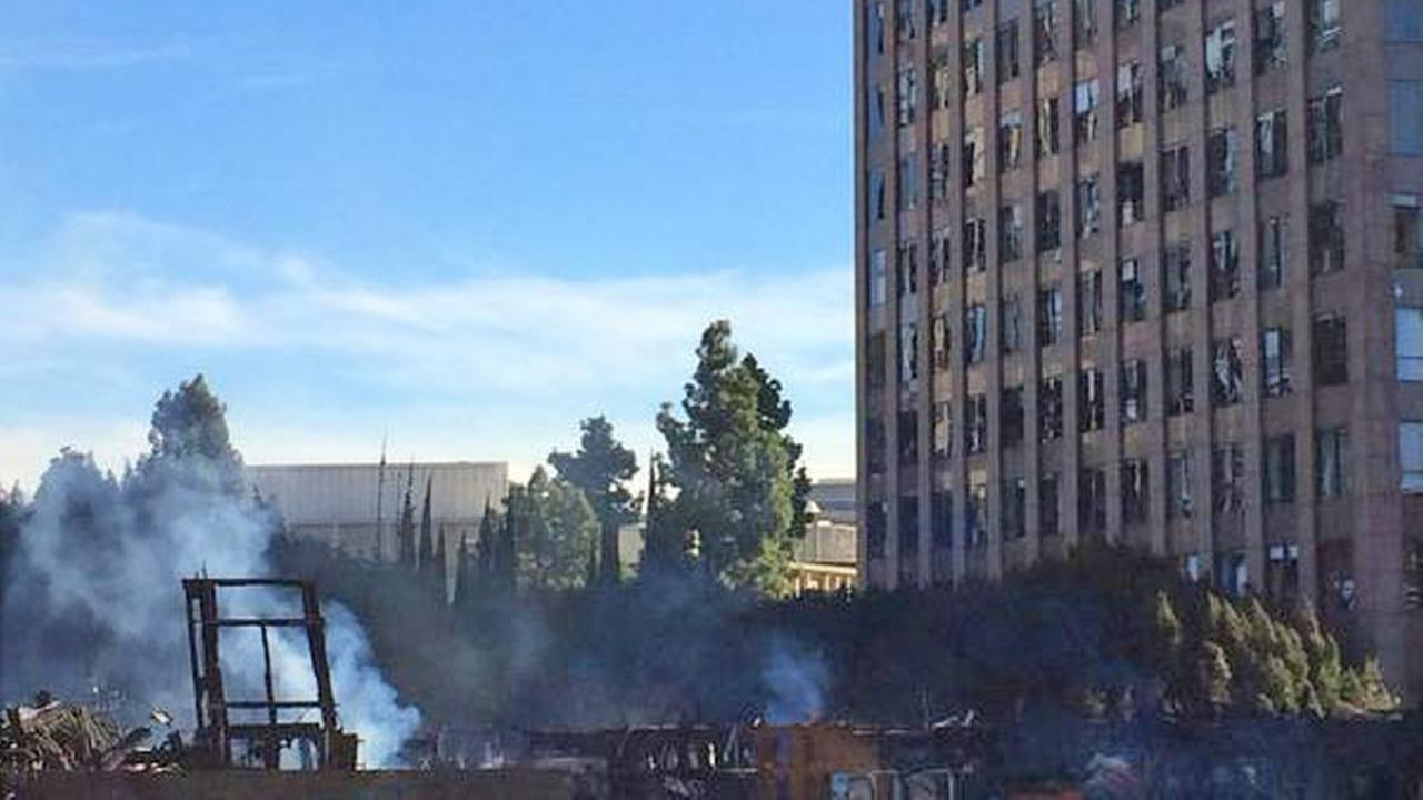 A fire at an apartment complex under construction in downtown Los Angeles damaged nearby buildings on Monday, Dec. 8, 2014.