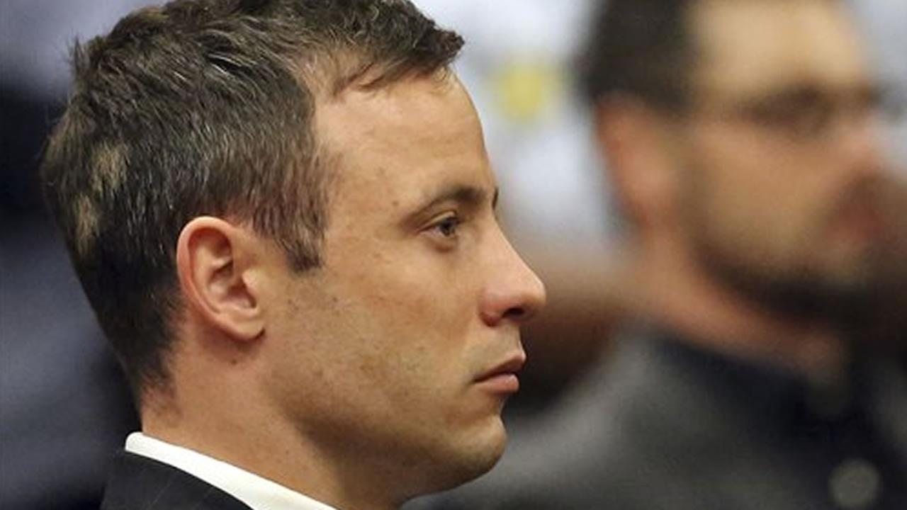 Oscar Pistorius sits in court in Pretoria, South Africa, Tuesday, Oct. 21, 2014.