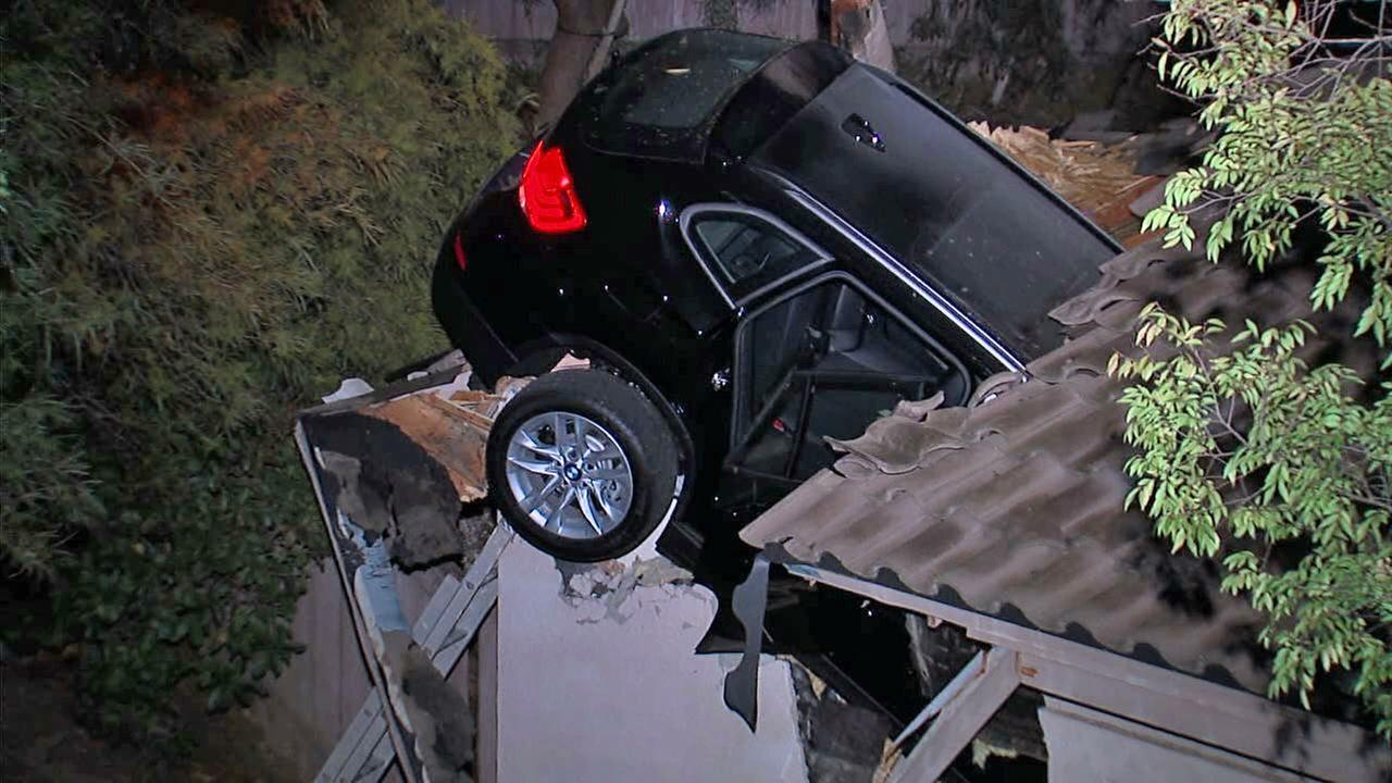An SUV went airborne and crashed through the roof of an Escondido home on Wednesday, Dec. 10, 2014.