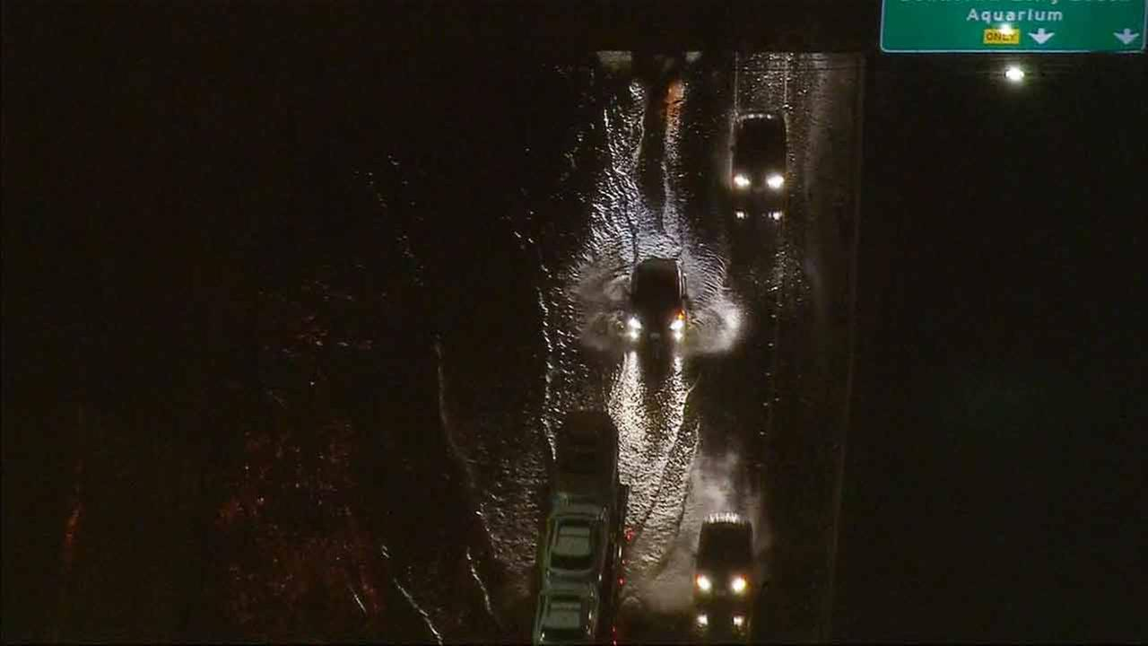 All lanes of the 710 Freeway were closed at Pacific Coast Highway due to flooding in Long Beach on Friday, Dec. 12, 2014.