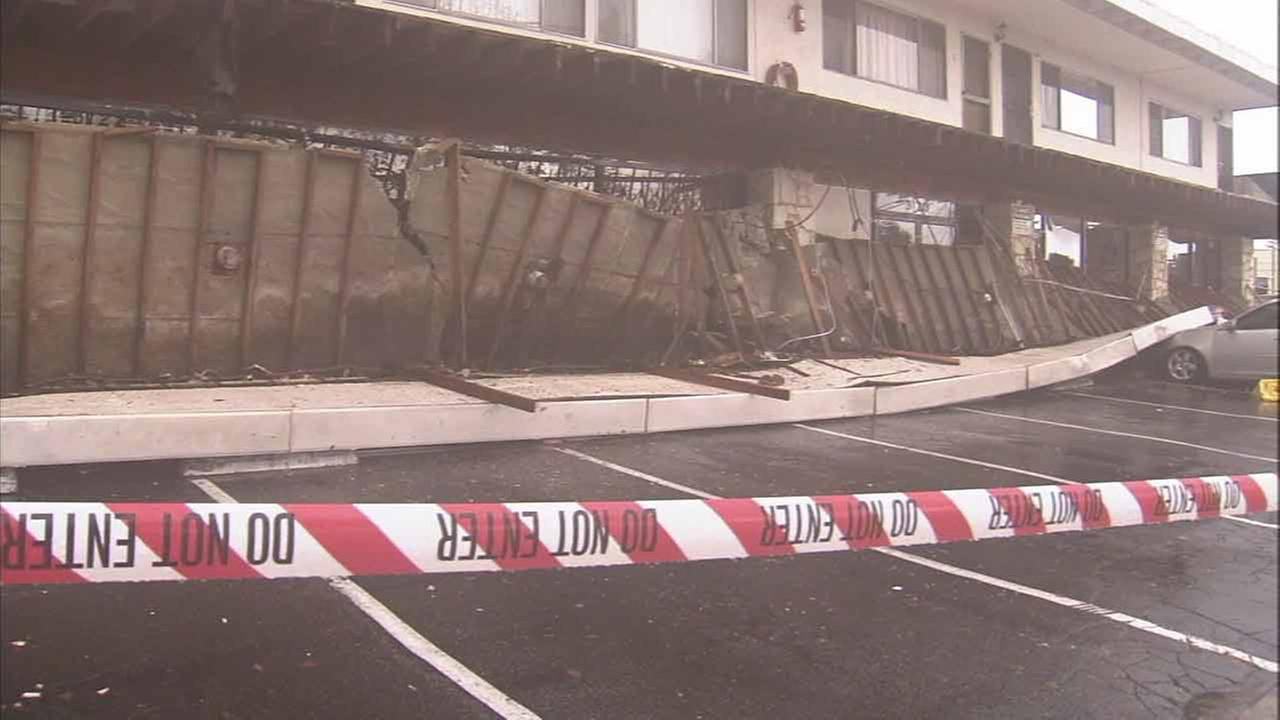 Pounding rain and powerful winds collapsed a second-story balcony at an apartment complex in Long Beach on Friday, Dec. 12, 2014.