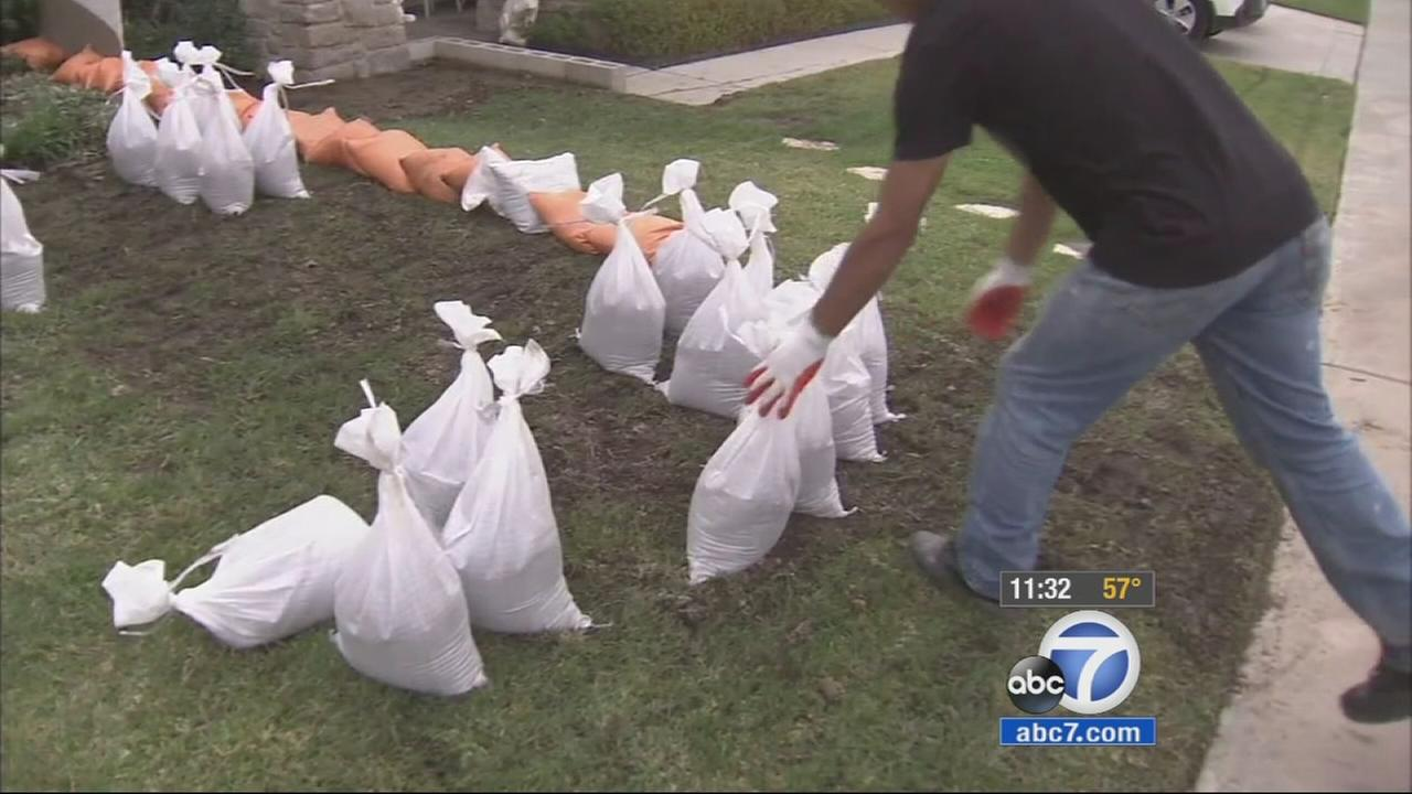 Azusa residents stack sand bags ahead of rain expected to hit on Tuesday, Dec. 16, 2014.
