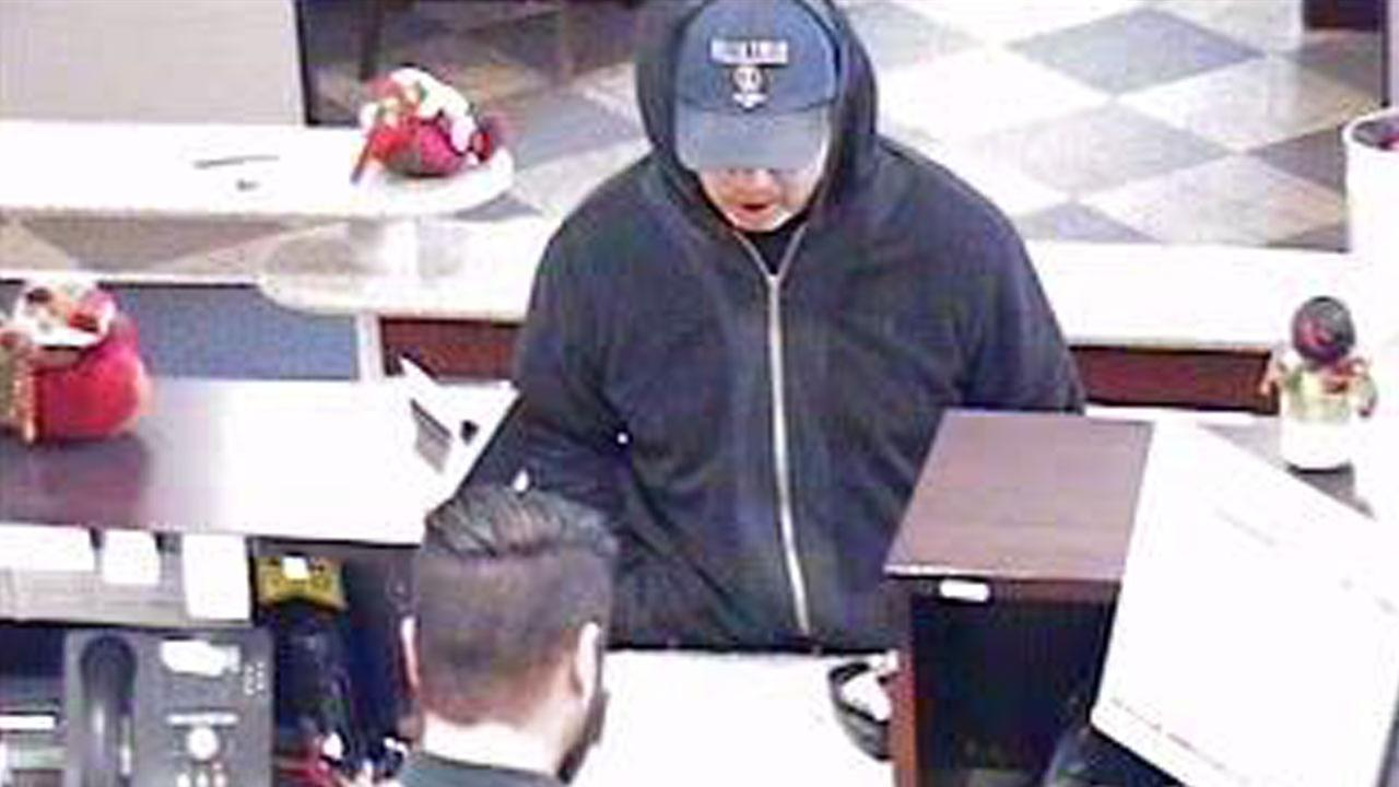 Still images from a surveillance video show a male suspect robbing a bank in the 5300 block of University Drive in Irvine Monday, Dec. 15, 2014.