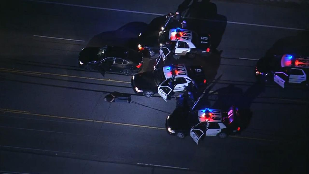 A male suspect surrenders after leading Los Angeles police on a chase across city streets and two freeways on Wednesday, Dec. 17, 2014.