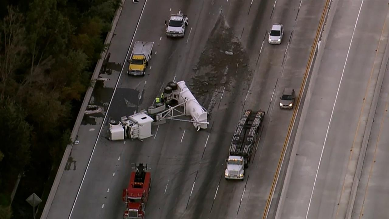 A truck overturned on the northbound 57 Freeway at the 60 Freeway in Diamond Bar on Thursday, Dec. 18, 2014.