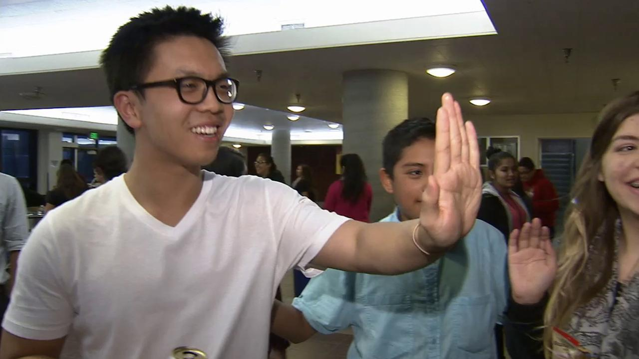 Cool Kid Simon Chow gives a high-five in this undated file photo.