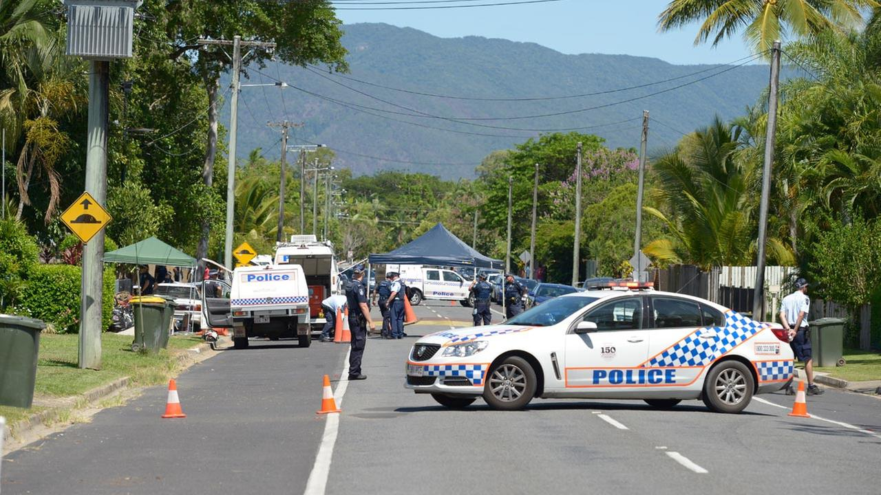 Police block the road outside a house where eight children have been found dead the Cairns suburb of Manoora, Australia, Friday, Dec. 19, 2014.