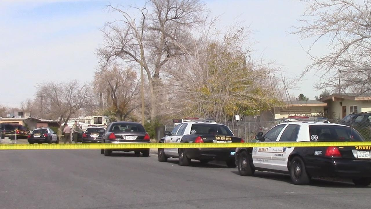 Detectives with the L.A. County Sheriffs Department investigate a shooting in the 37800 block of Melton Avenue in Palmdale Friday, Dec. 19, 2014.