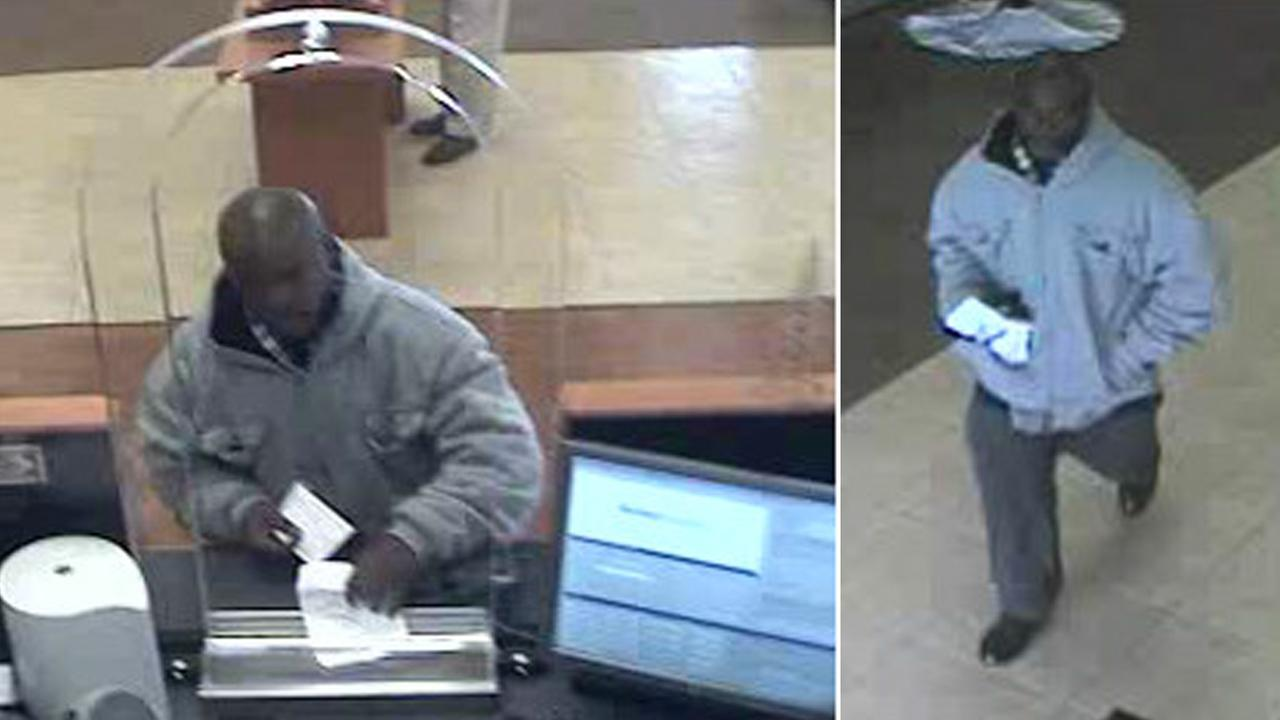 A man hands a note to rob a Chase Bank in Seal Beach on Saturday, Dec. 20, 2014.