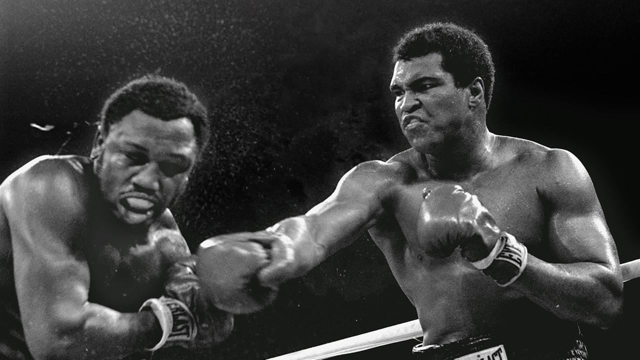 Spray flies from the Joe Frazier as heavyweight champion Muhammad Ali connects with a right in the ninth round of their title fight in Manila, Philippines,  October 1, 1975.