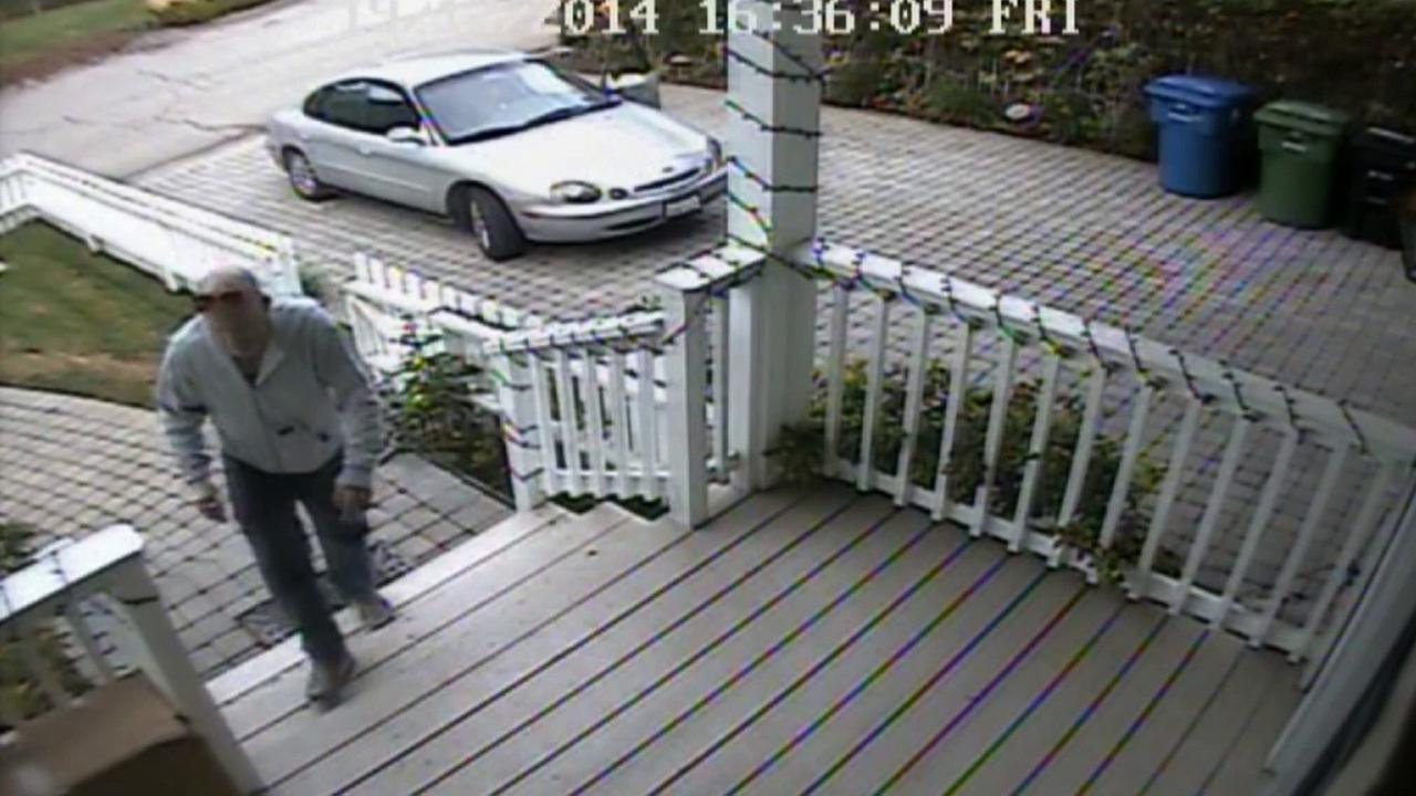 A man steals multiple packages from a Studio City home on Friday, Dec. 21, 2014.