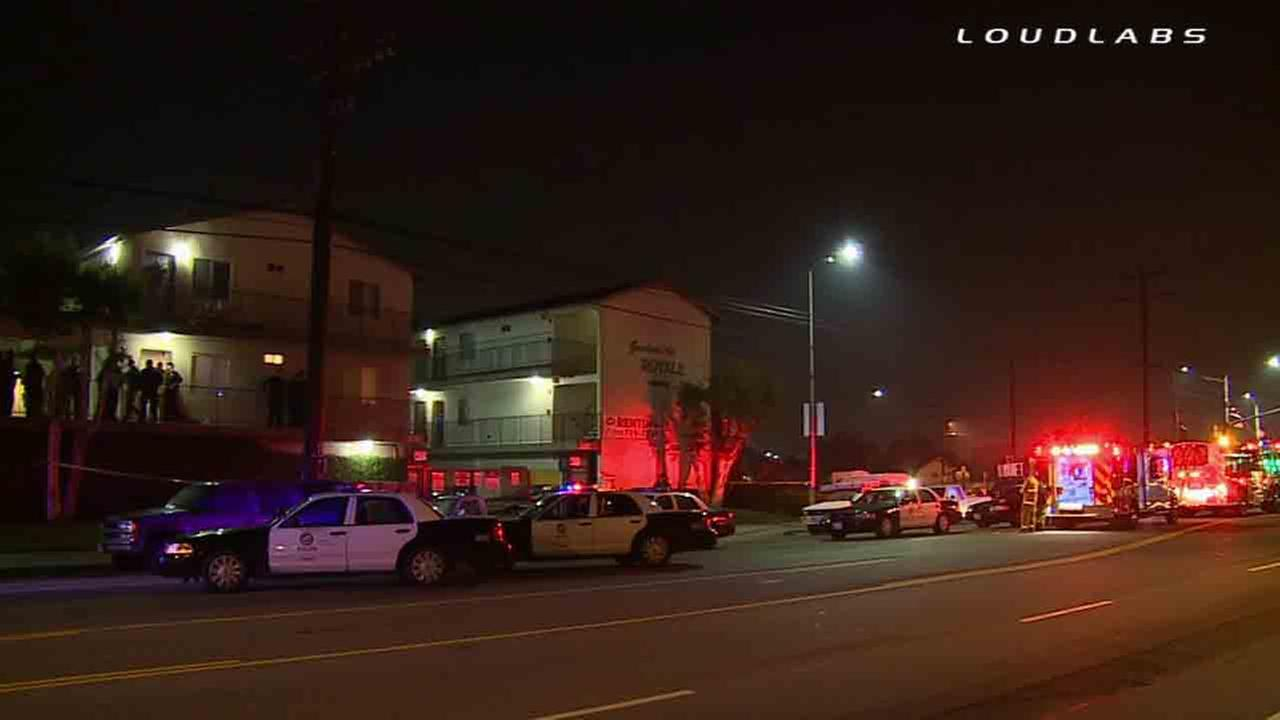 Los Angeles police respond to the scene of a homicide in the 16200 block of South Figueroa Street Monday, Dec. 22, 2014.