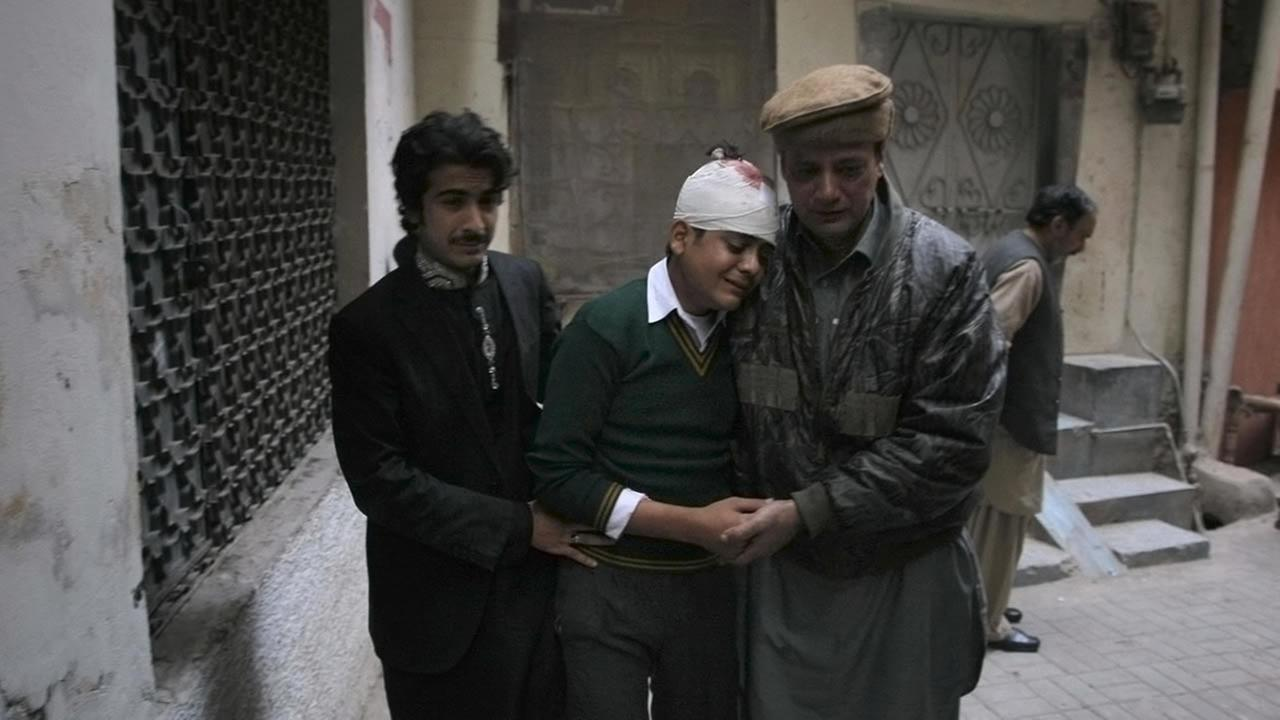 Injured student Mohammad Baqair, center, is comforted as he mourns the death of his mother who was a teacher at a school attacked by the Taliban, in Peshawar, Dec. 16, 2014.