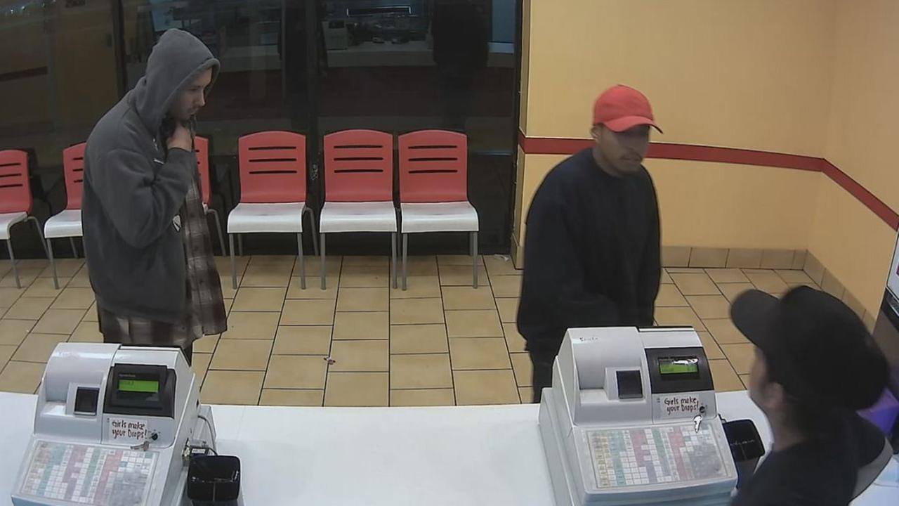Two men, shown above, are suspected of robbing a Pronto Pizza restaurant in Santa Ana on Saturday, Dec. 20, 2014.
