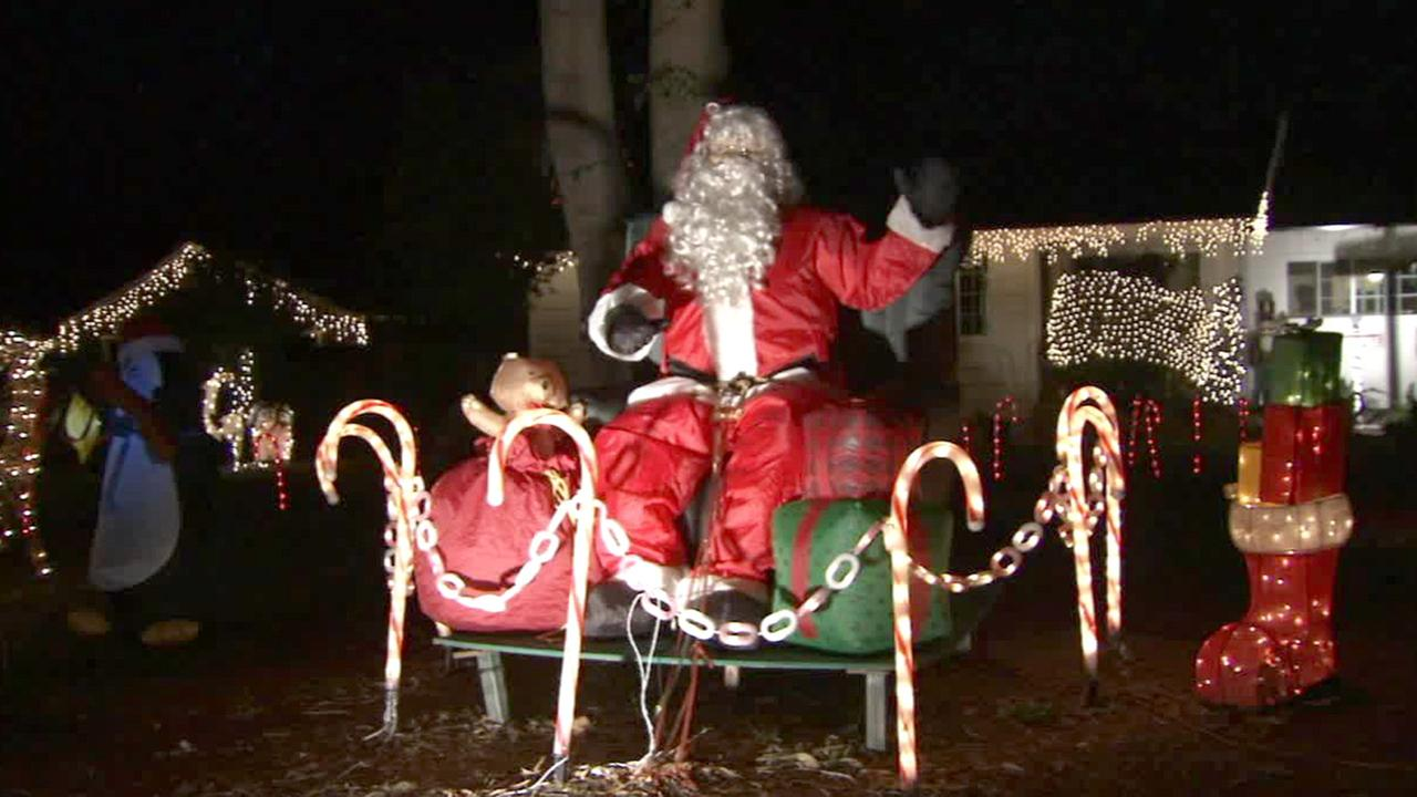 Holiday decorations light up Candy Cane Lane in Woodland Hills on Wednesday, Dec. 24, 2014.