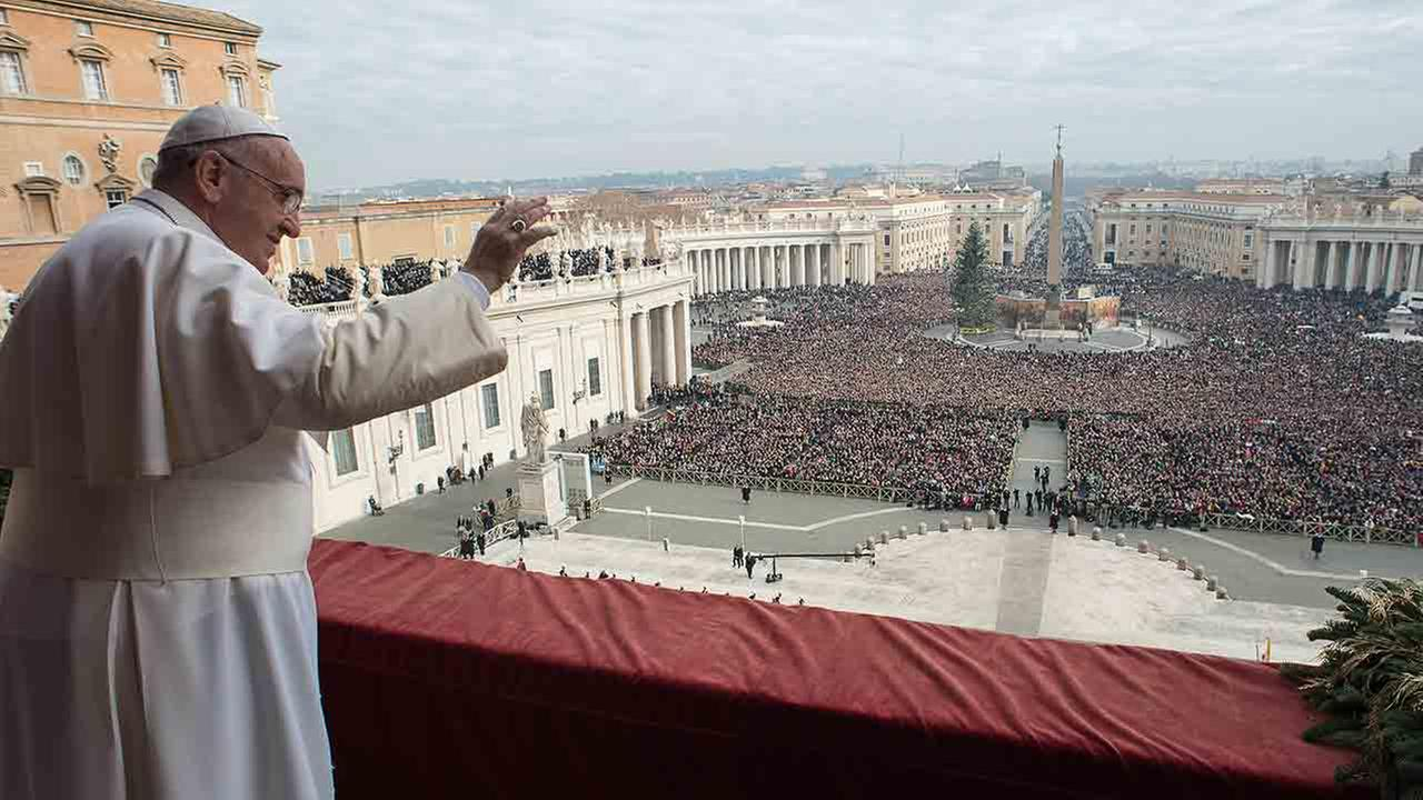 In this picture provided by the Vatican newspaper LOsservatore Romano, Pope Francis delivers his Urbi et Orbi (to the city and to the world) blessing from the central balcony of St. Peters Basilica at the Vatican, Thursday, Dec. 25, 2014.