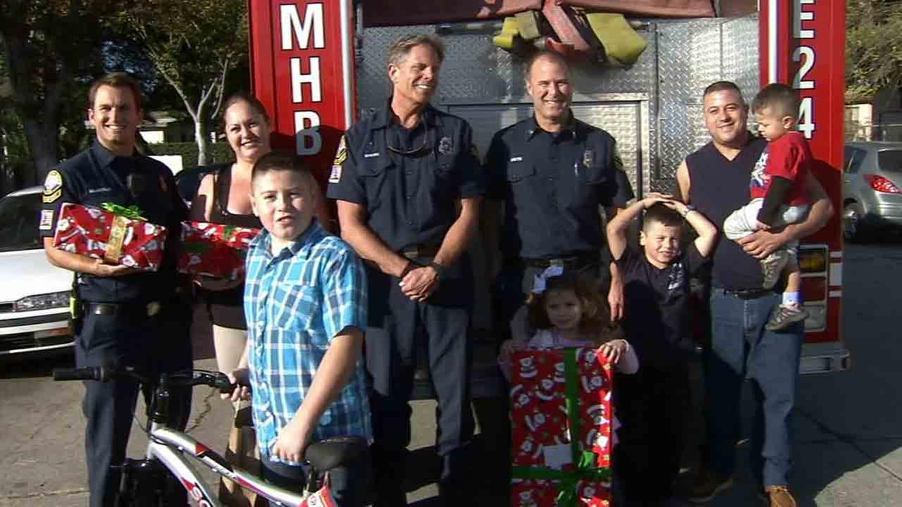 Firefighters from Manhattan Beach brought some real Christmas cheer to a Lynwood family thats struggling to make ends meet.