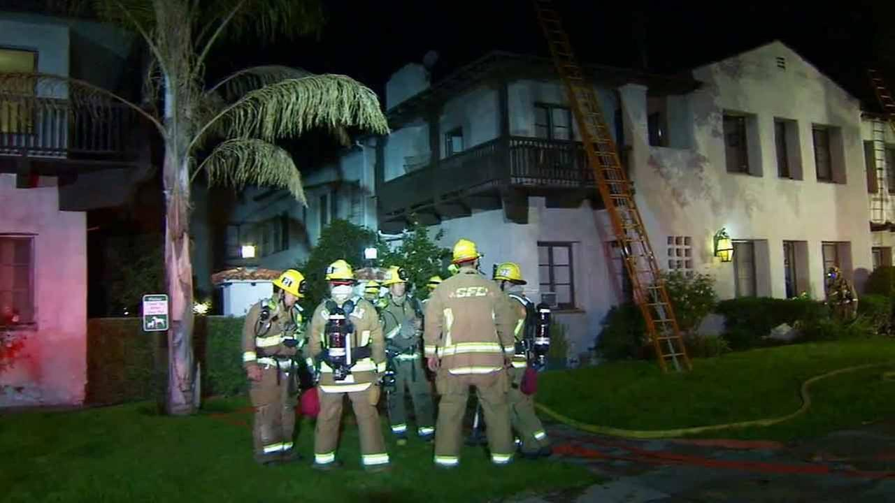 Firefighters are shown at the scene of an apartment fire in Glendale on Friday, Dec.