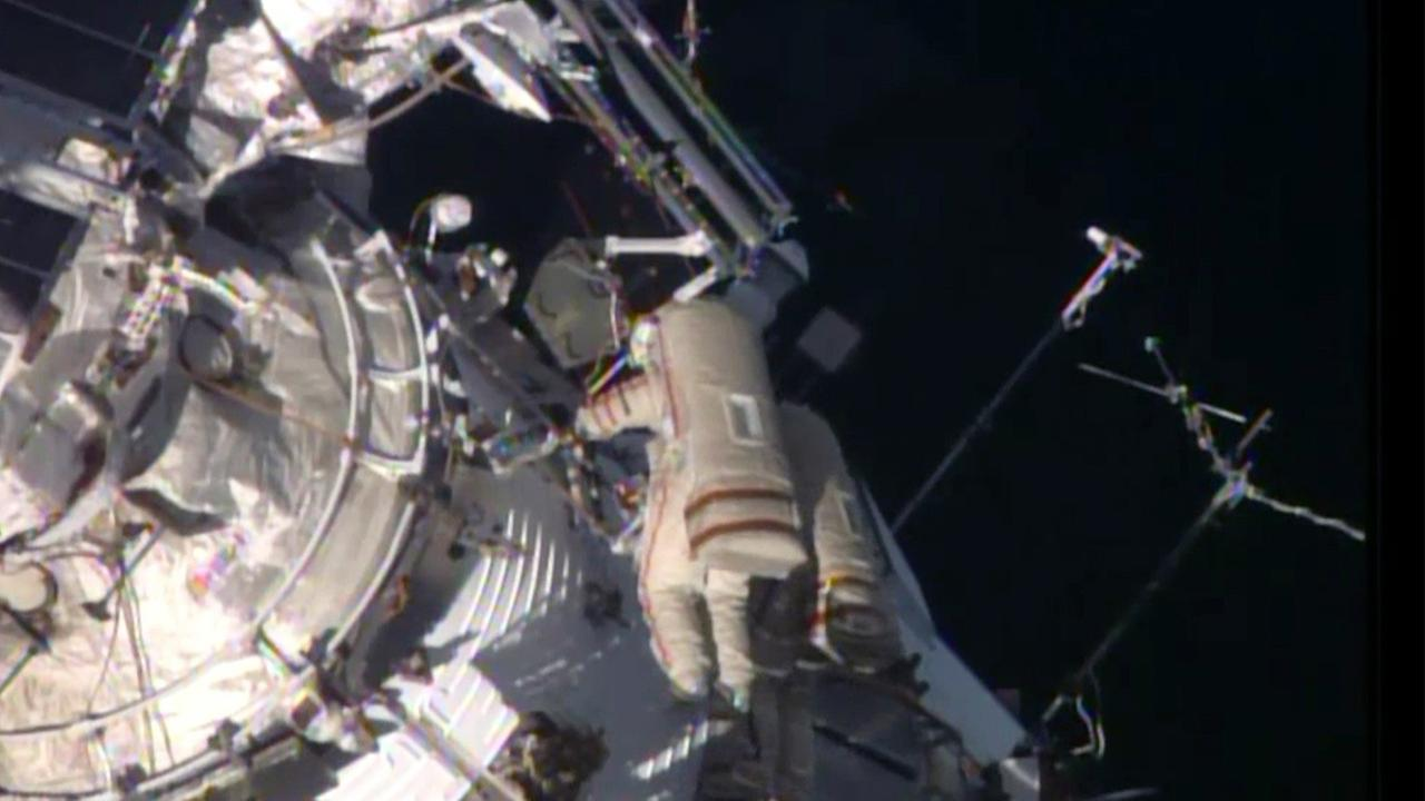 This image from a live NASA feed shows astronauts Maxim Suraev and Alexander Samokutyaev during a spacewalk outside the International Space Station on Wednesday, Oct. 22, 2014.