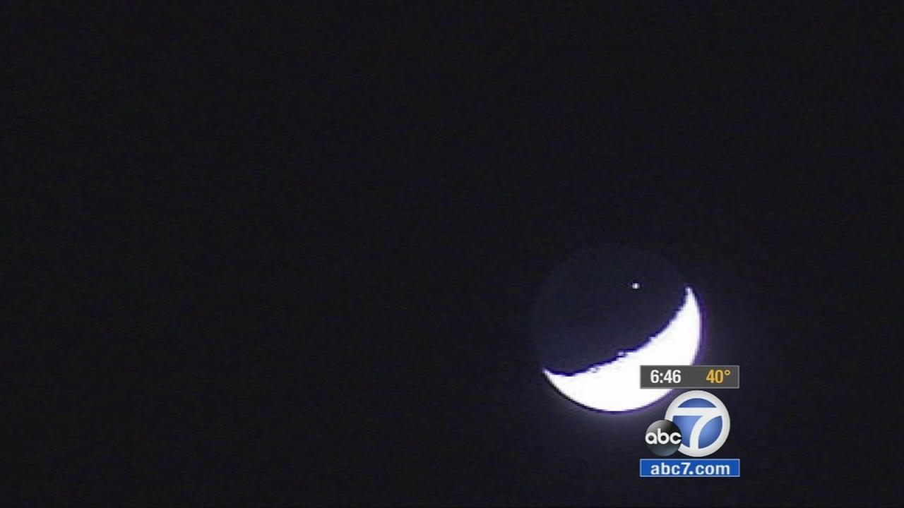 The International Space Station passed over the Los Angeles area right in front of the moon Friday night.