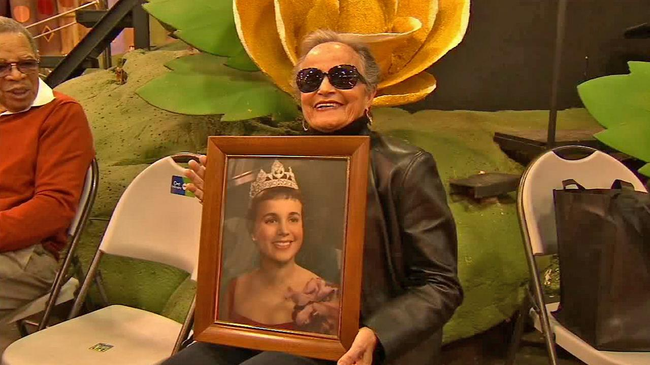 Joan Williams, 83, holds a portrait of herself as Miss Crown City in 1958, on Saturday, Dec. 27, 2014. She will ride in the 2015 Rose Parade after being denied because of her race.