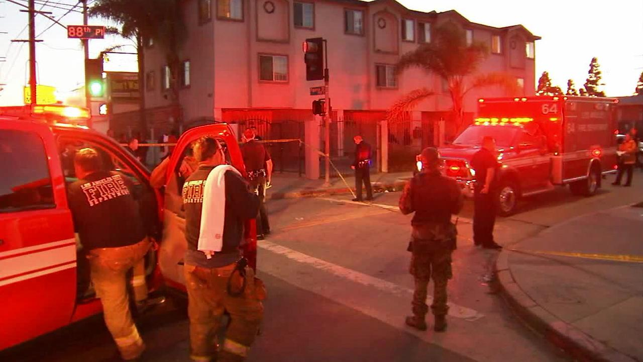 Authorities on scene after a shooting in South Los Angeles that left one person dead on Saturday, Dec. 27, 2014.