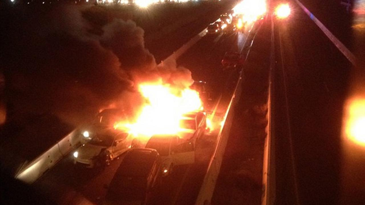 A photo shows cars on fire after a crash on the southbound 215 in Perris on Saturday, Dec. 27, 2014.