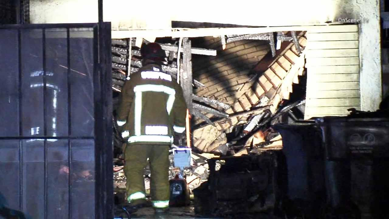 Firefighters are shown at the scene of a fire in Compton on Saturday, Dec. 27, 2014.