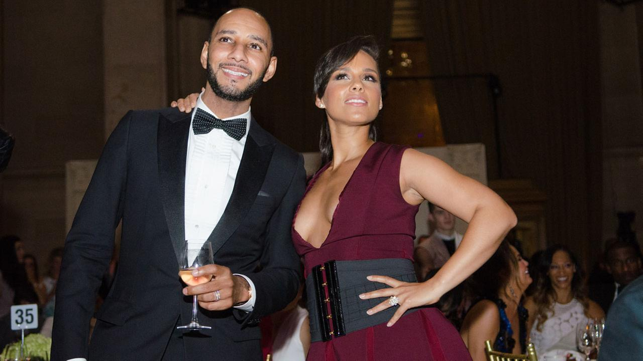 Swizz Beatz and Alicia Keys enjoy the sounds of Janelle Monae at The Gordon Parks Foundation Awards Dinner and Auction at Ciprianis Wall Street on Tuesday, June 3, 2014, in NY.