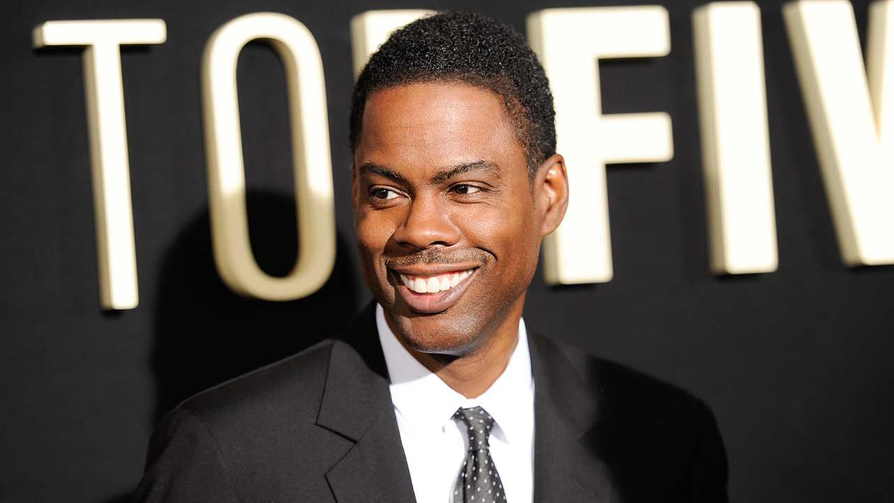 Actor/director Chris Rock attends the premiere of Top Five at the Ziegfeld Theatre on Wednesday, Dec. 3, 2014, in New York.