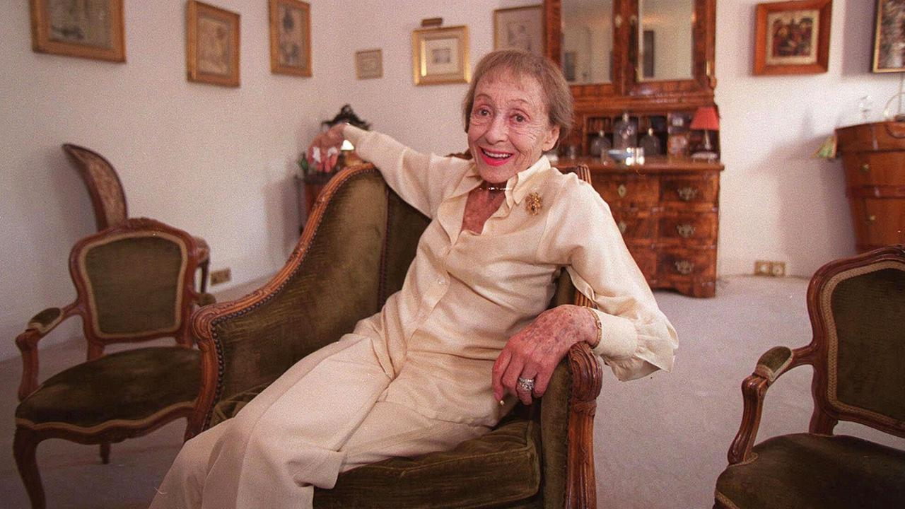 In this July 29, 1999 file photo, actress Luise Rainer poses in her central London apartment.AP Photo/Adam Butler