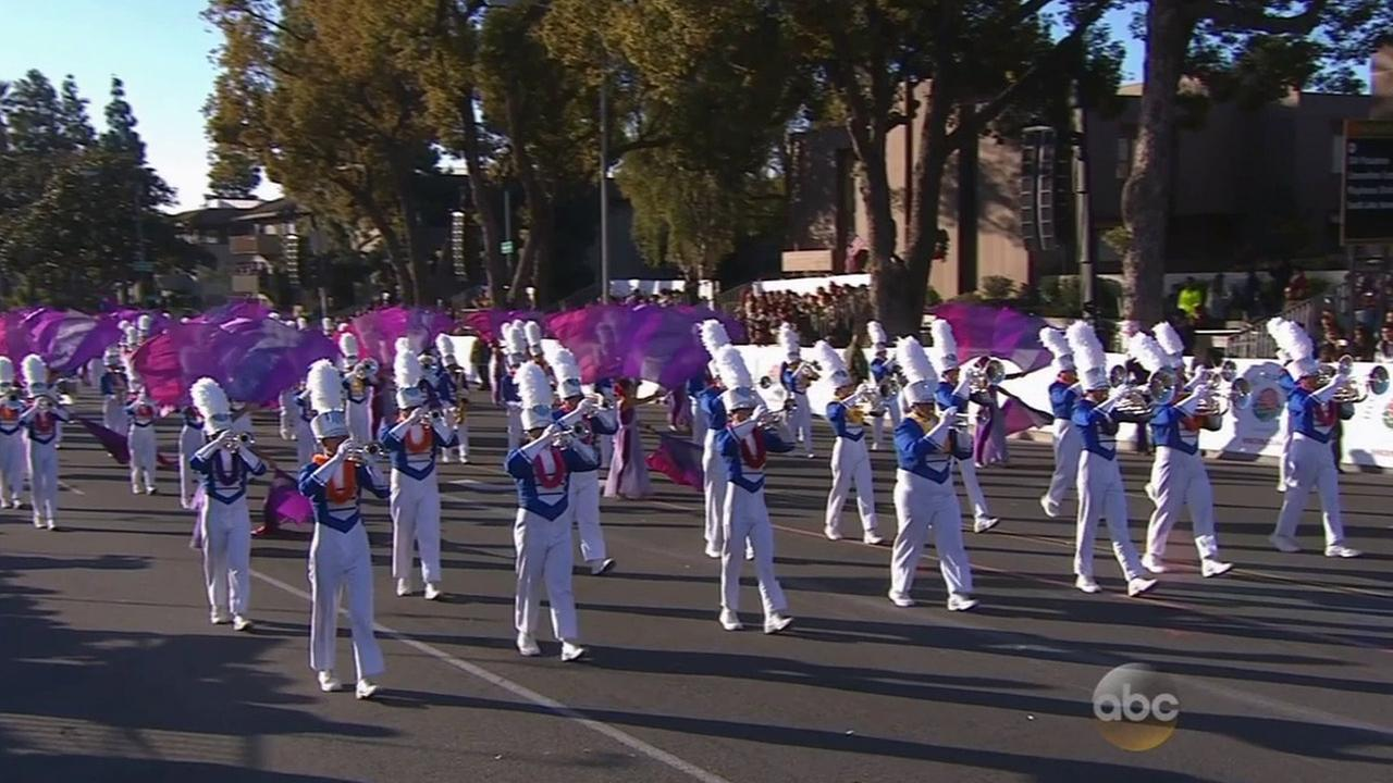 The Maui High School marching band and color guard, comprising 136 students, march through the streets of Pasadena for the Rose Parade.