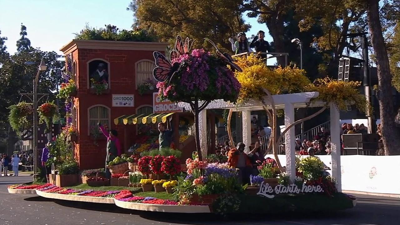 Riders on the Green Grocer float wave hello to visitors at the 126th Rose Parade in Pasadena on Jan. 1, 2015.