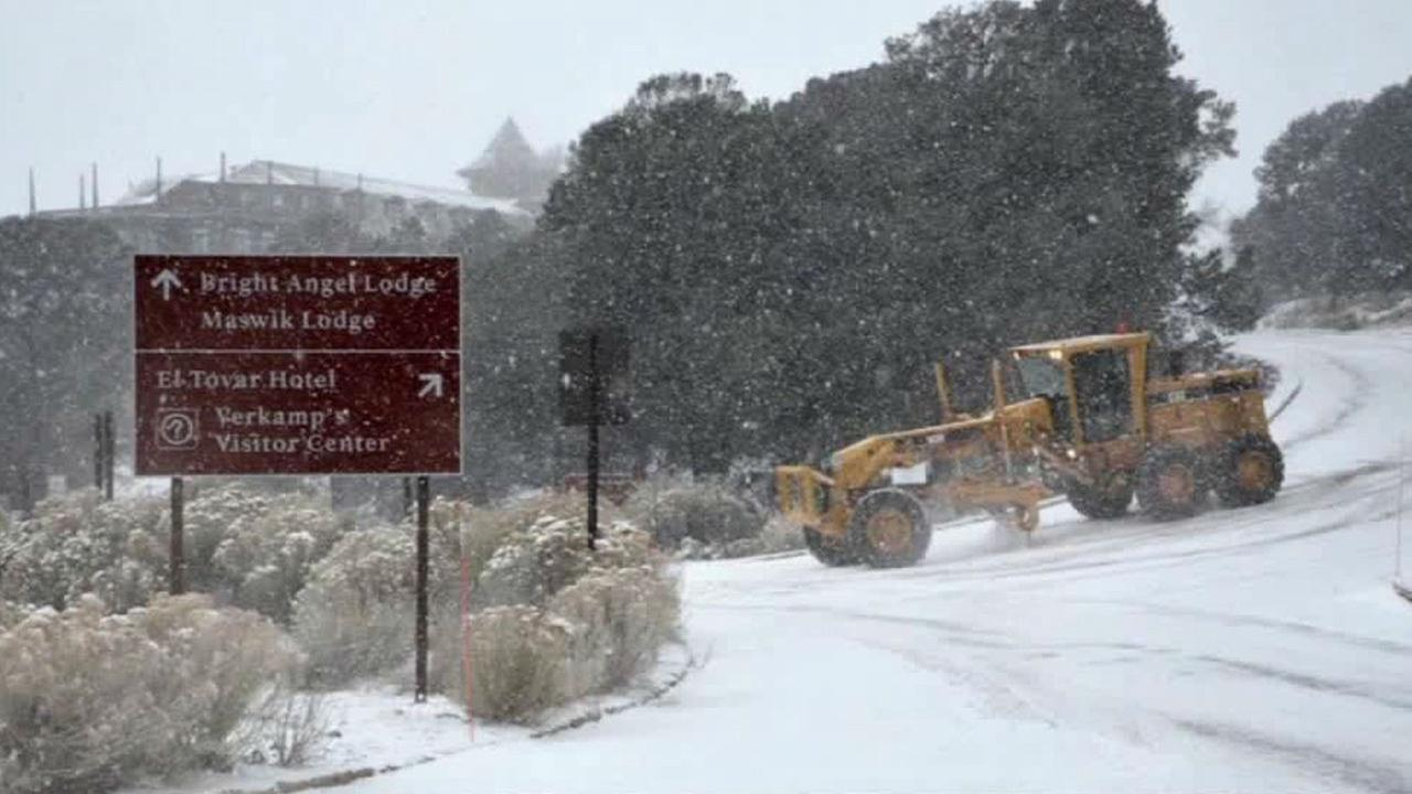 A Grand Canyon Park snow plow works to clear snow on New Years Eve.