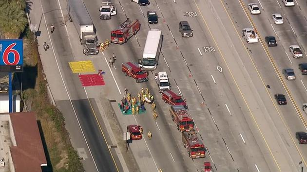 A charter bus crashed into a semi-truck on the eastbound 60 Freeway near 7th Avenue in Hacienda Heights on Wednesday, Jan. 7, 2015. <span class=meta></span>