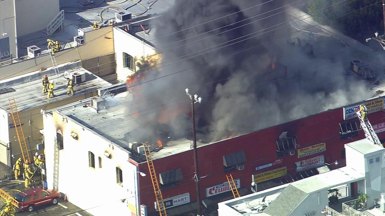 Firefighters battle a building fire in the Hollywood area on Tuesday, May 6, 2014.