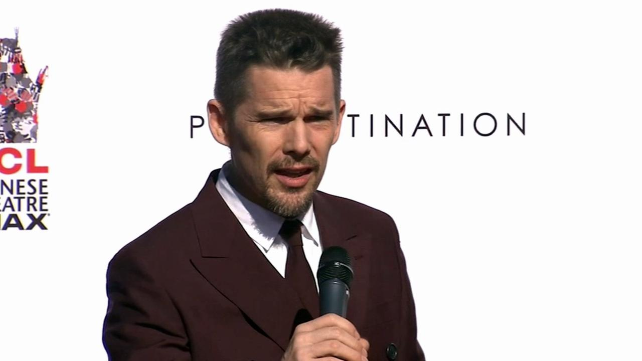 Actor Ethan Hawke gives a speech before planting his hands and feet in cement at the TCL Chinese Theatre in Hollywood on Thursday, Jan. 8, 2015.