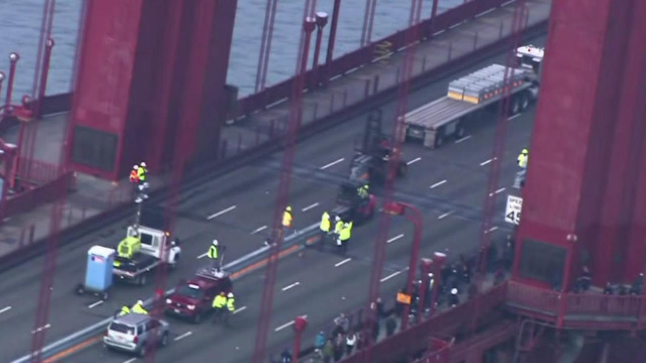 Yellow-clad work crews shared San Franciscos iconic Golden Gate Bridge with only bikers, runners, and seabirds Saturday, Jan. 10, 2015.