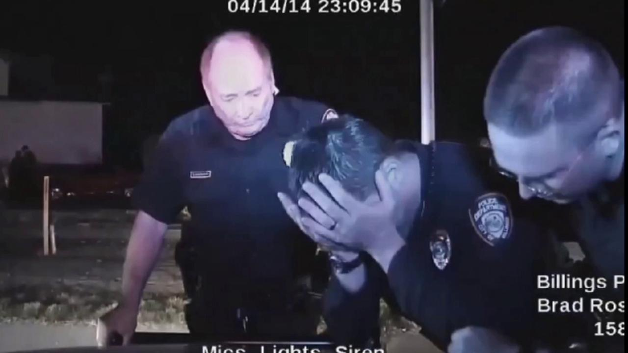 Billings Police Officer Grant Morrison cries into his hands after he fatally shoots an unarmed man during a traffic stop on April 14, 2014.