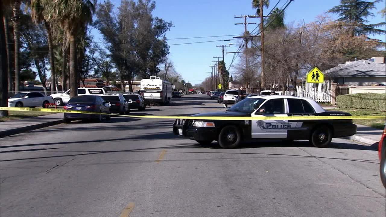 Police on scene of a standoff in San Bernardino on Tuesday, Jan. 13, 2015.
