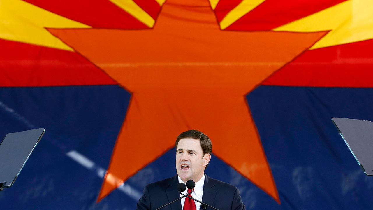 In this Jan. 5, 2015, file photo, Republican Arizona Gov. Doug Ducey addresses the crowd after being sworn in during inauguration ceremonies at the Arizona Capitol in Phoenix.
