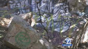 Graffiti is shown in Cucamonga Canyon. There is a growing effort to restore the canyons natural beauty.