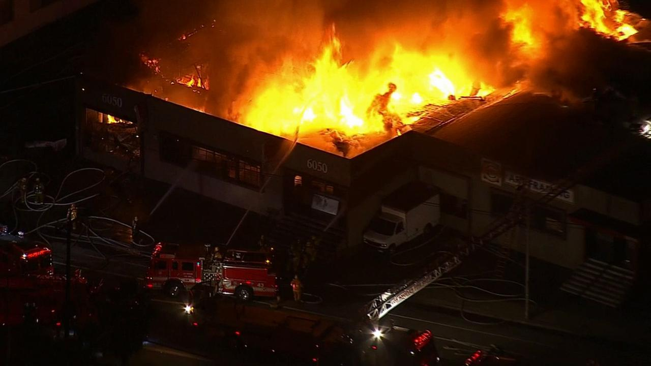 Firefighters work to put out a fire that broke out in a commercial building on W. Jefferson Boulevard in Culver City on Friday, Jan. 16, 2015.