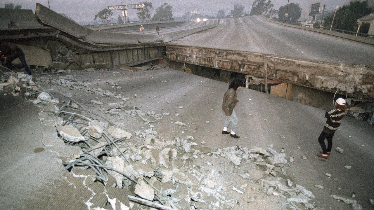 In this Jan. 17, 1994 file photo, the Santa Monica Freeway has split and collapsed over La Cienega Boulevard following the Northridge quake in the predawn hours.