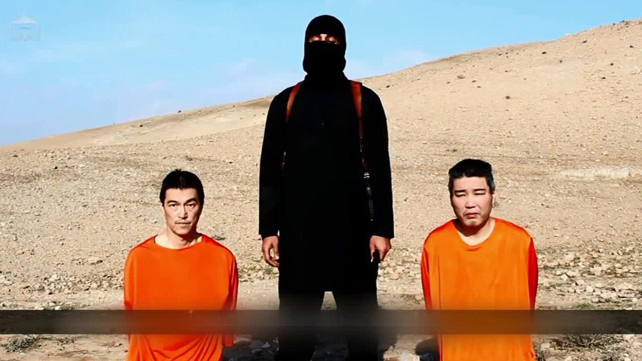 An online video released Tuesday, Jan. 19, 2015, purported to show the Islamic State group threatening to kill two Japanese hostages.